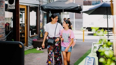 Woman and child walking in Fortitude Valley