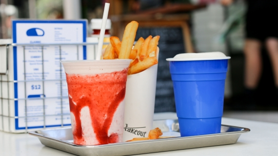 Strawberry milkshake, beer and hot chips